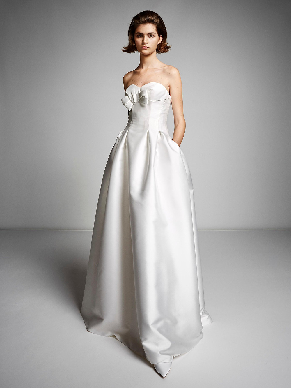 A Viktor & Rolf strapless silk A-line wedding dress with pockets and a bow