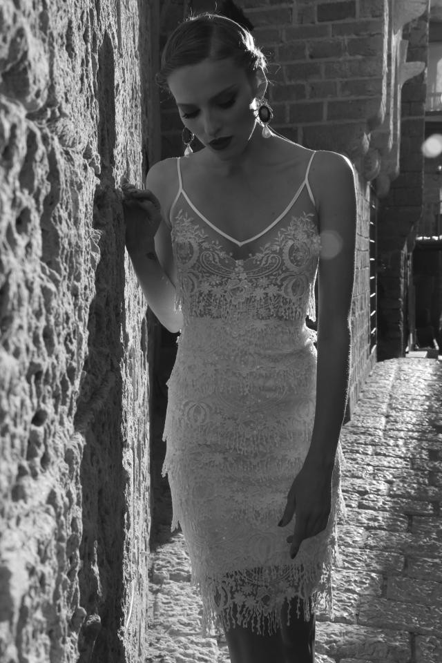 A Galia Lahav short lace wedding dress with thin spaghetti straps