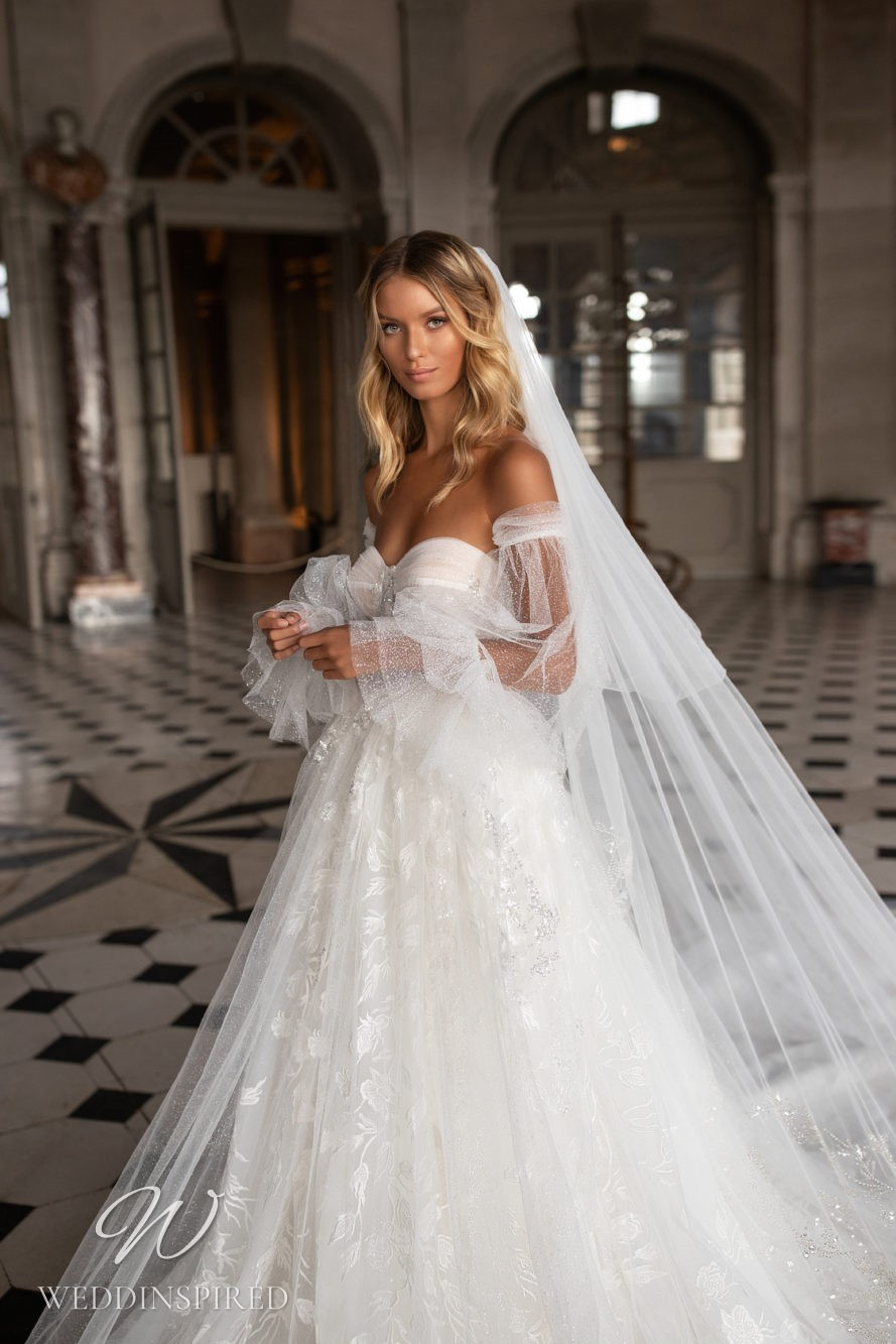 A Milla Nova tulle off the shoulder princess ball gown wedding dress
