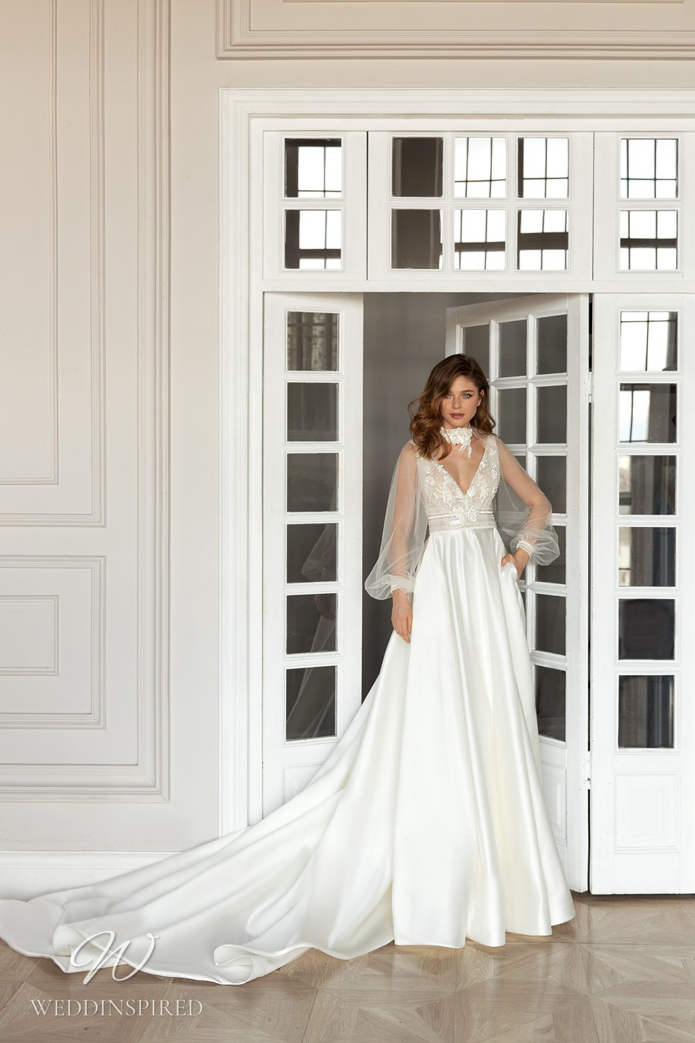 An Eva Lendel 2021 silk and lace A-line wedding dress with long sleeves and pockets