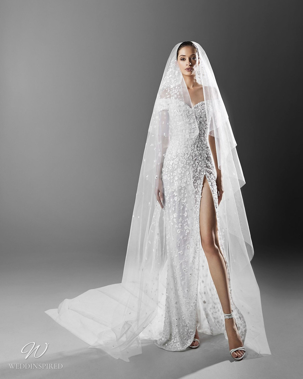 A Zuhair Murad sexy off the shoulder wedding dress with a high slit, crystals and a veil