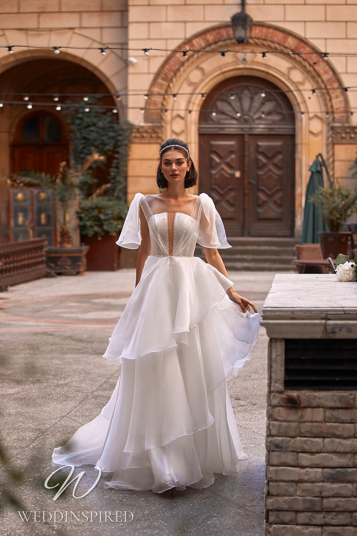A Daria Karlozi 2021 chiffon A-line wedding dress with a ruffle skirt