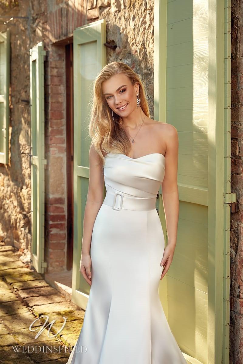 An Eddy K 2021 strapless simple satin mermaid wedding dress