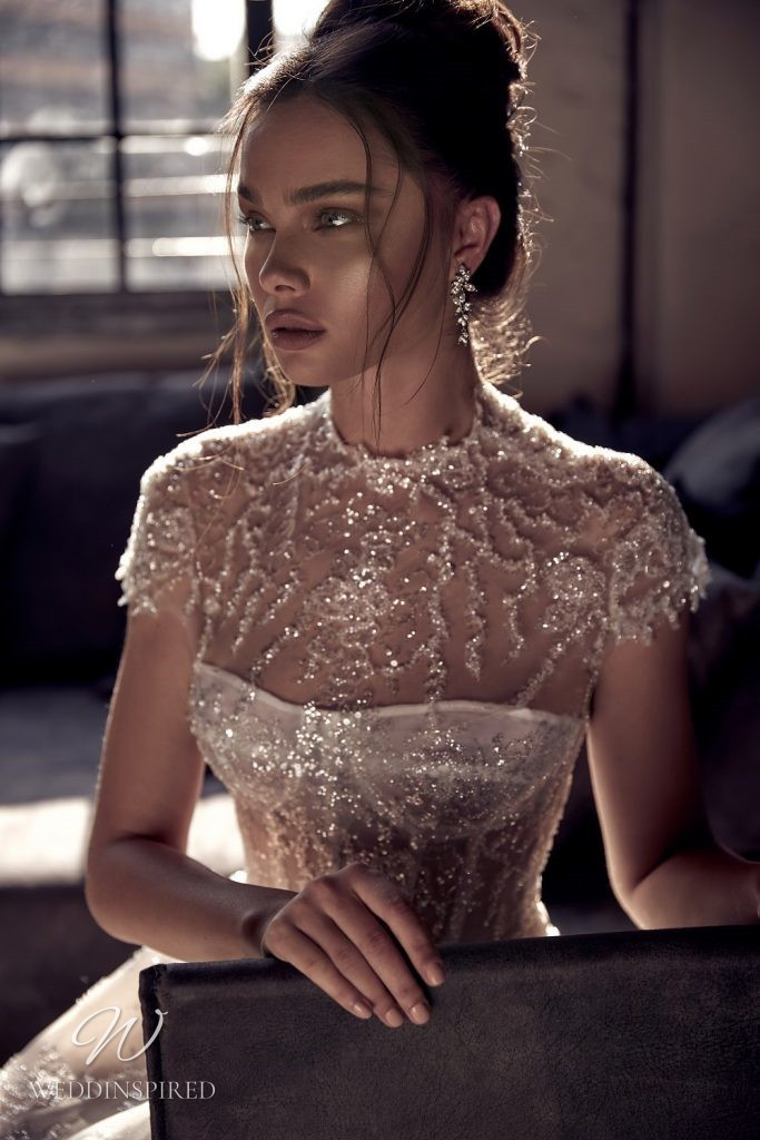 A Julie Vino 2021 strapless sparkle blush lace and tulle mermaid wedding dress with a bustier top with sparkle removable jacket