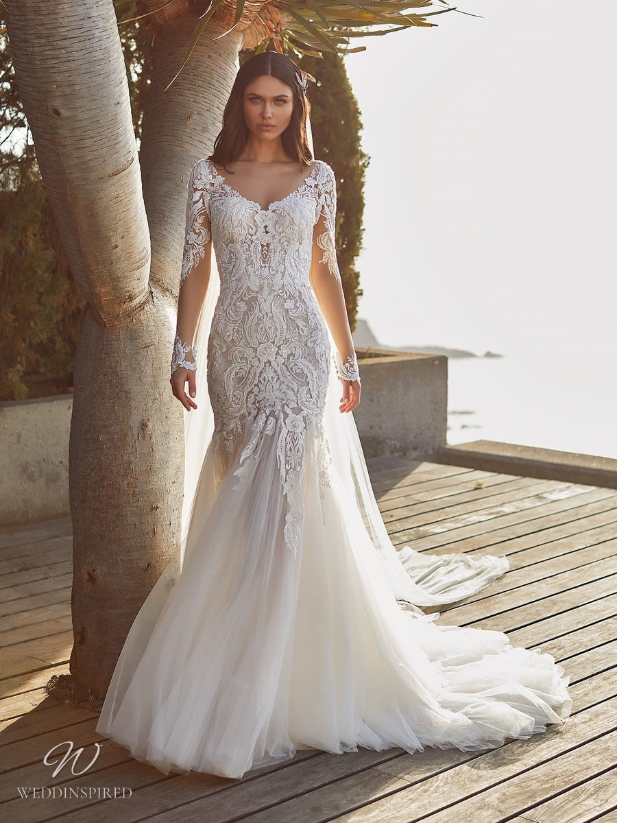 A Pronovias 2021 lace and tulle mermaid wedding dress with long sleeves