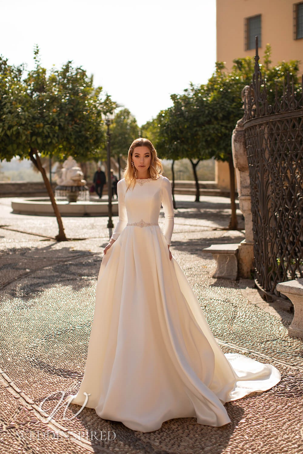 An Essential by Lussano 2021 modest satin A-line wedding dress with long sleeves