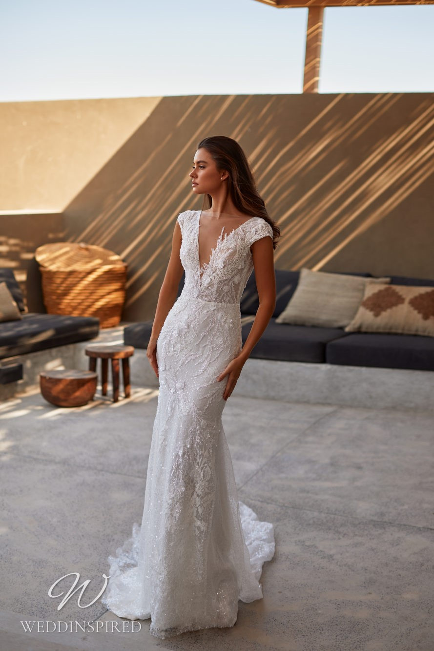A Milla by Lorenzo Rossi 2021/2022 lace mermaid wedding dress with cap sleeves and a v neck
