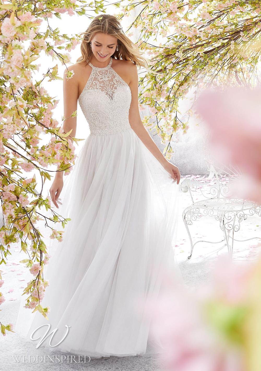 A Madeline Gardner lace and tulle halterneck A-line wedding dress