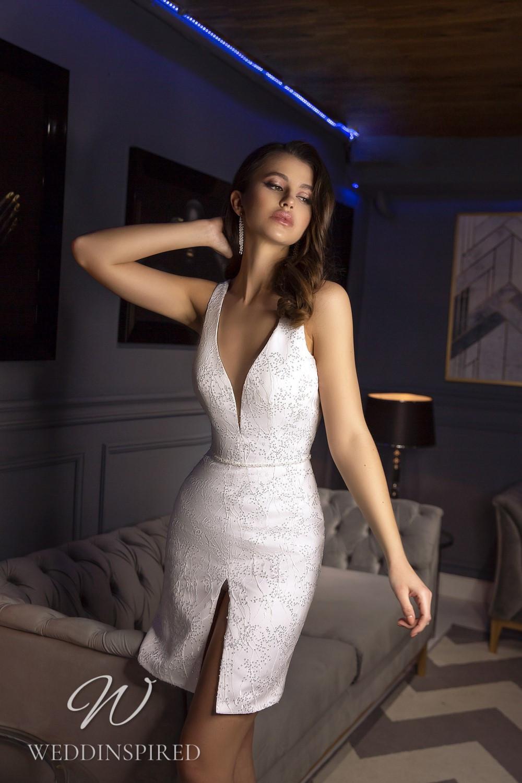 A Tina Valerdi short wedding dress with a v neck
