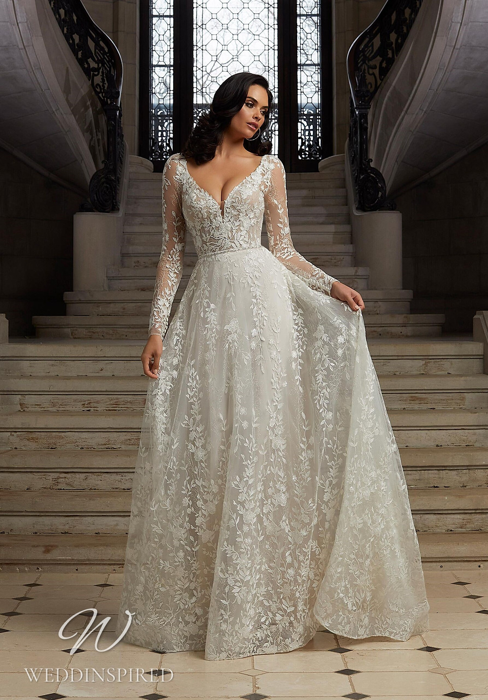 A Madeline Gardner lace A-line wedding dress with long sleeves