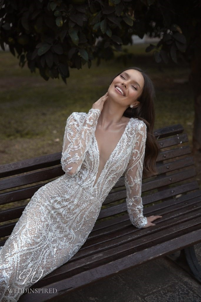 An Eden Aharon 2020 sparkly mesh mermaid fit and flare wedding dress with long sleeves and a v neckline