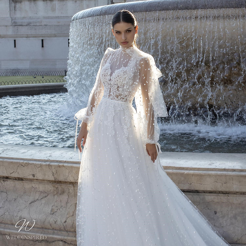 A Pinella Passaro lace and tulle A-line wedding dress with long sleeves