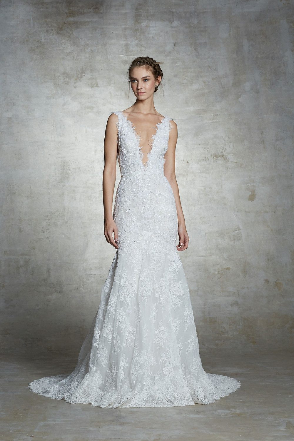 A Marchesa lace mermaid fit and flare wedding dress with a low v neckline