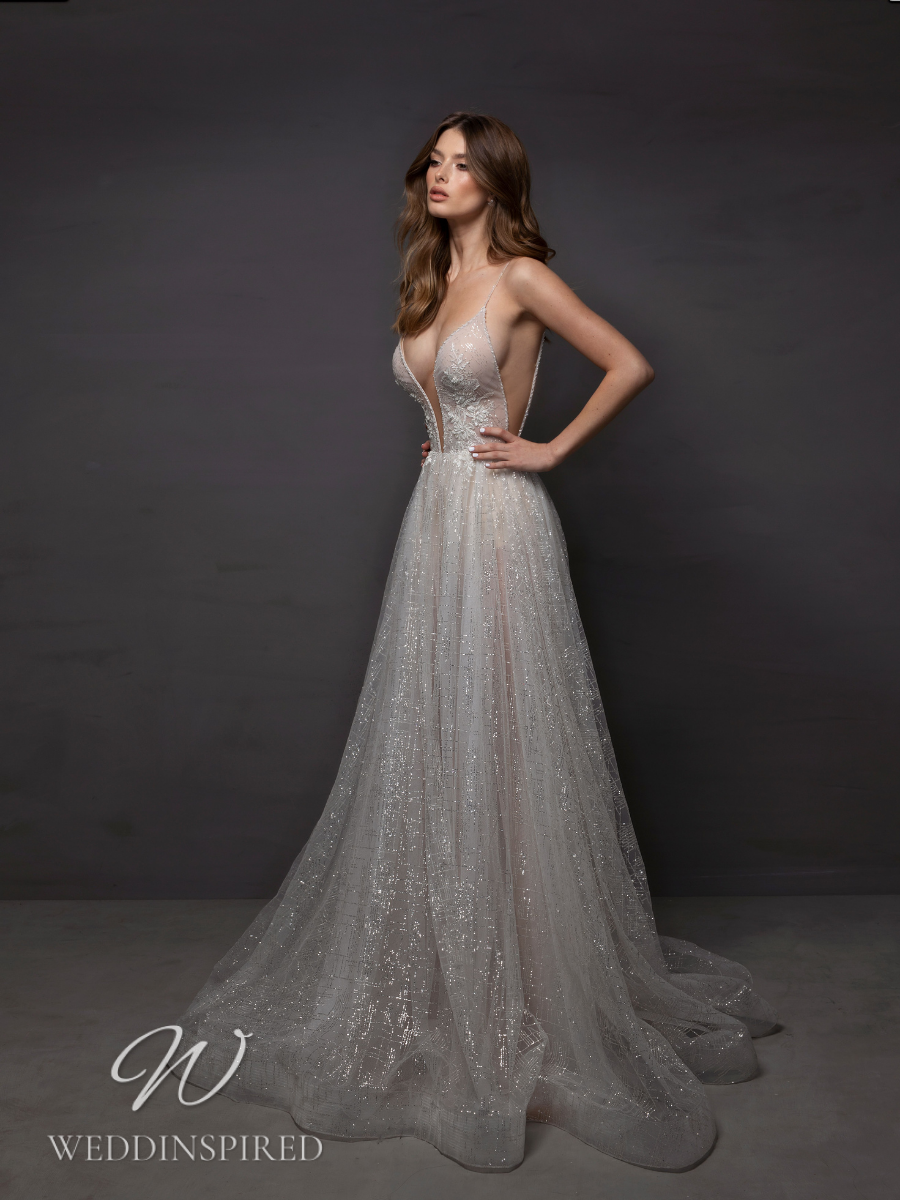 A Riki Dalal 2021 sparkly tulle A-line wedding dress with a v neck