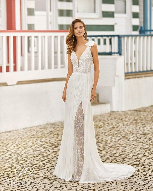 A Rosa Clara 2021 lace and chiffon A-line wedding dress with a v neck