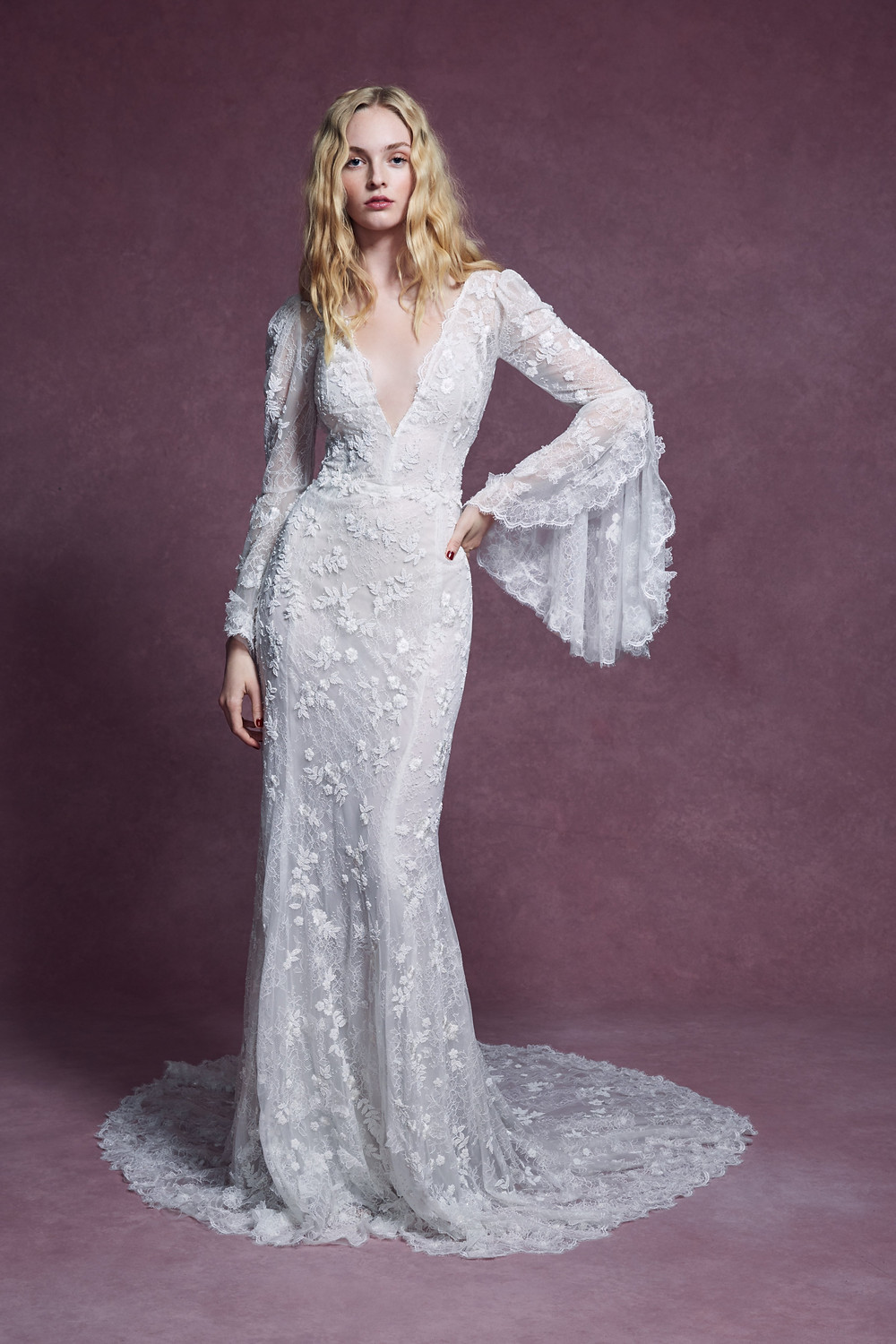 A Marchesa 2020 sheath bohemian inspired wedding dress, with a low v neckline, lace and long gypsy style sleeves