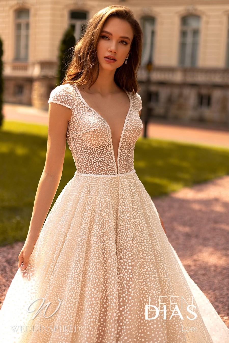 A Leen Dias 2021 blush tulle A-line wedding dress with a v neck