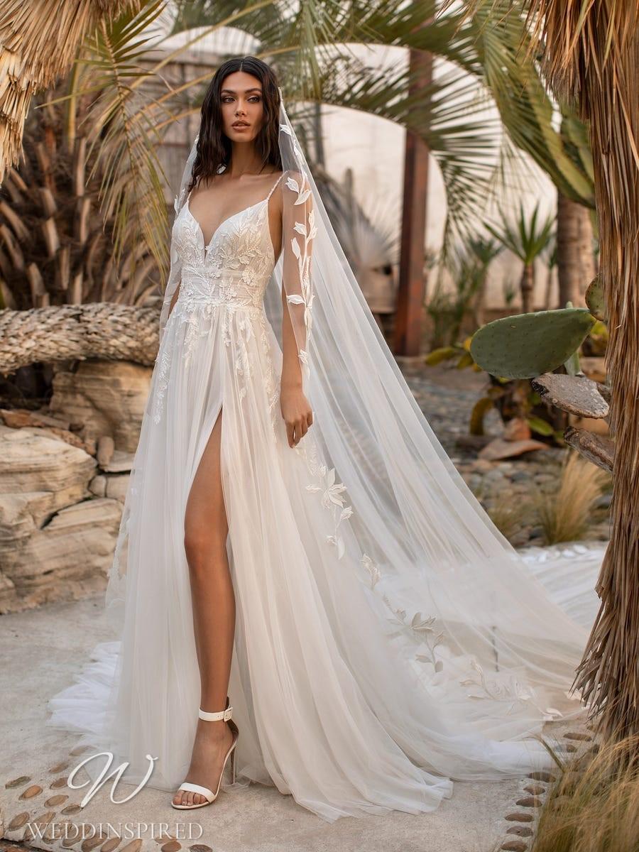 A Pronovias 2021 soft flowy A-line wedding dress with a v neck and straps
