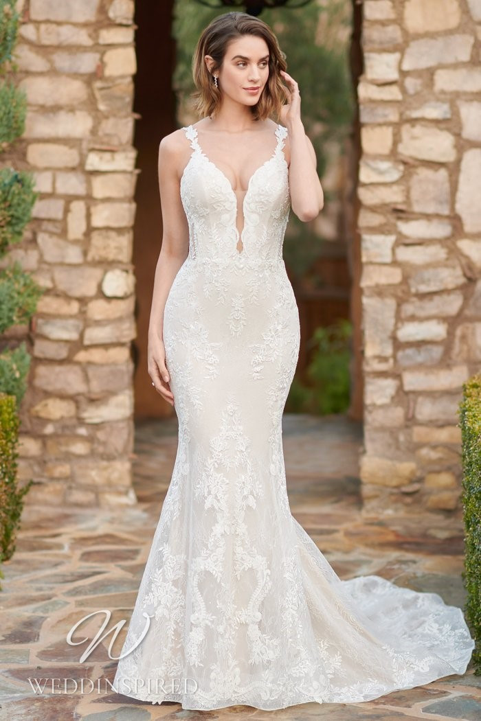 A Kenneth Winston 2021 lace mermaid wedding dress with a v neck and straps