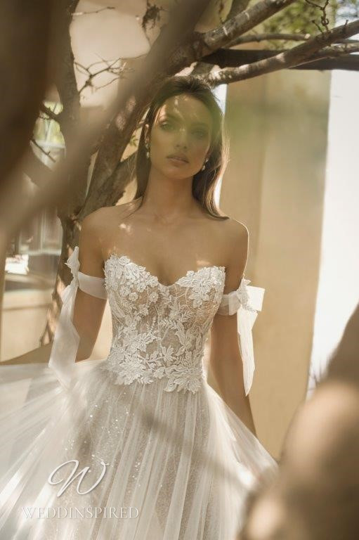 A David Hasbani lace and tulle strapless off the shoulder ball gown wedding dress
