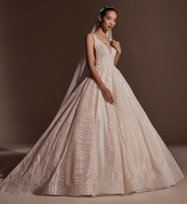 A Pronovias blush sparkly princess ball gown wedding dress