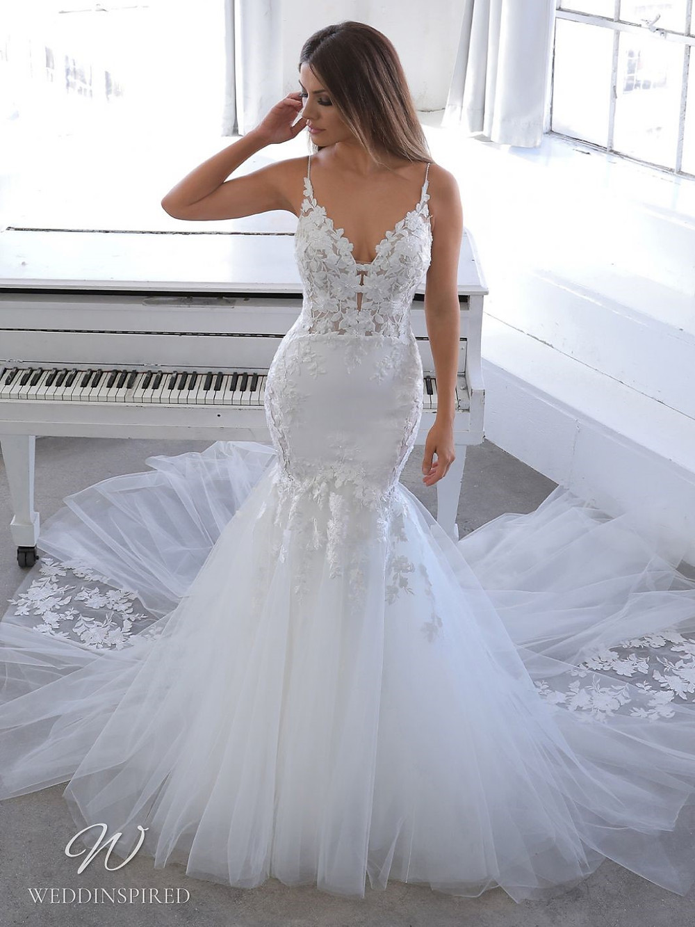 A Blue by Enzoani 2021 lace and tulle mermaid wedding dress with straps and a v neck