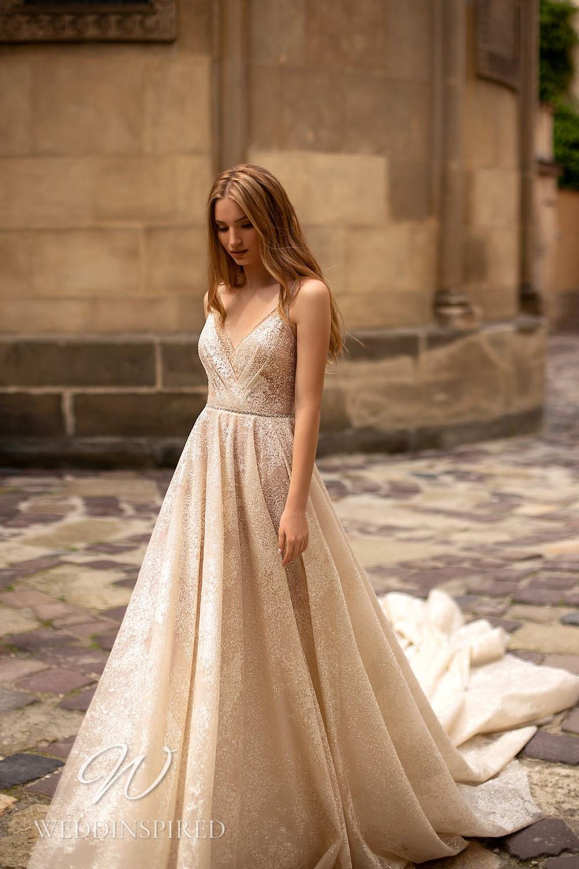 A WONÁ Concept 2021 champagne A-line wedding dress with a v neck