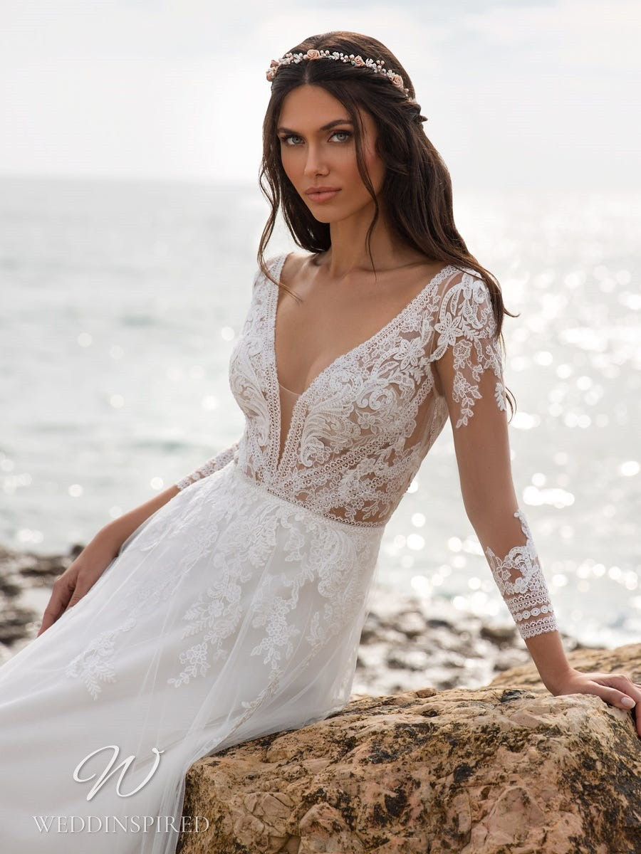 A Pronovias 2021 lace A-line wedding dress with long sleeves and a v neck