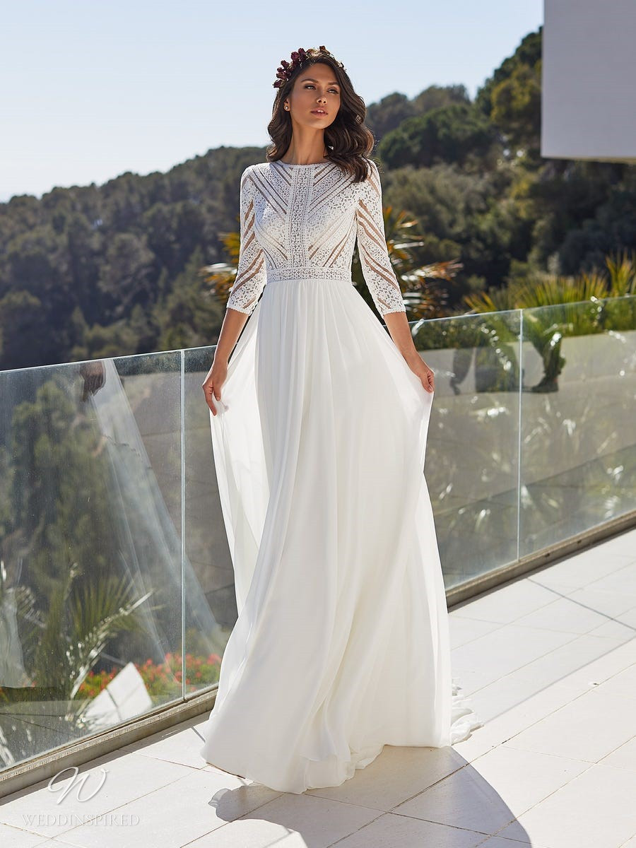 A Pronovias 2021 Grecian style chiffon and lace A-line wedding dress with a high neckline and half sleeves