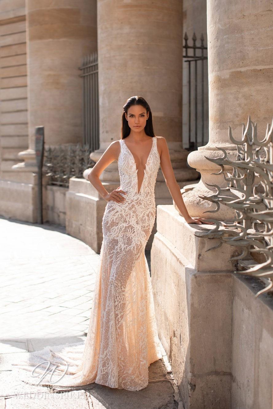 A Milla Nova romantic blush mermaid wedding dress with lace and a low v neckline