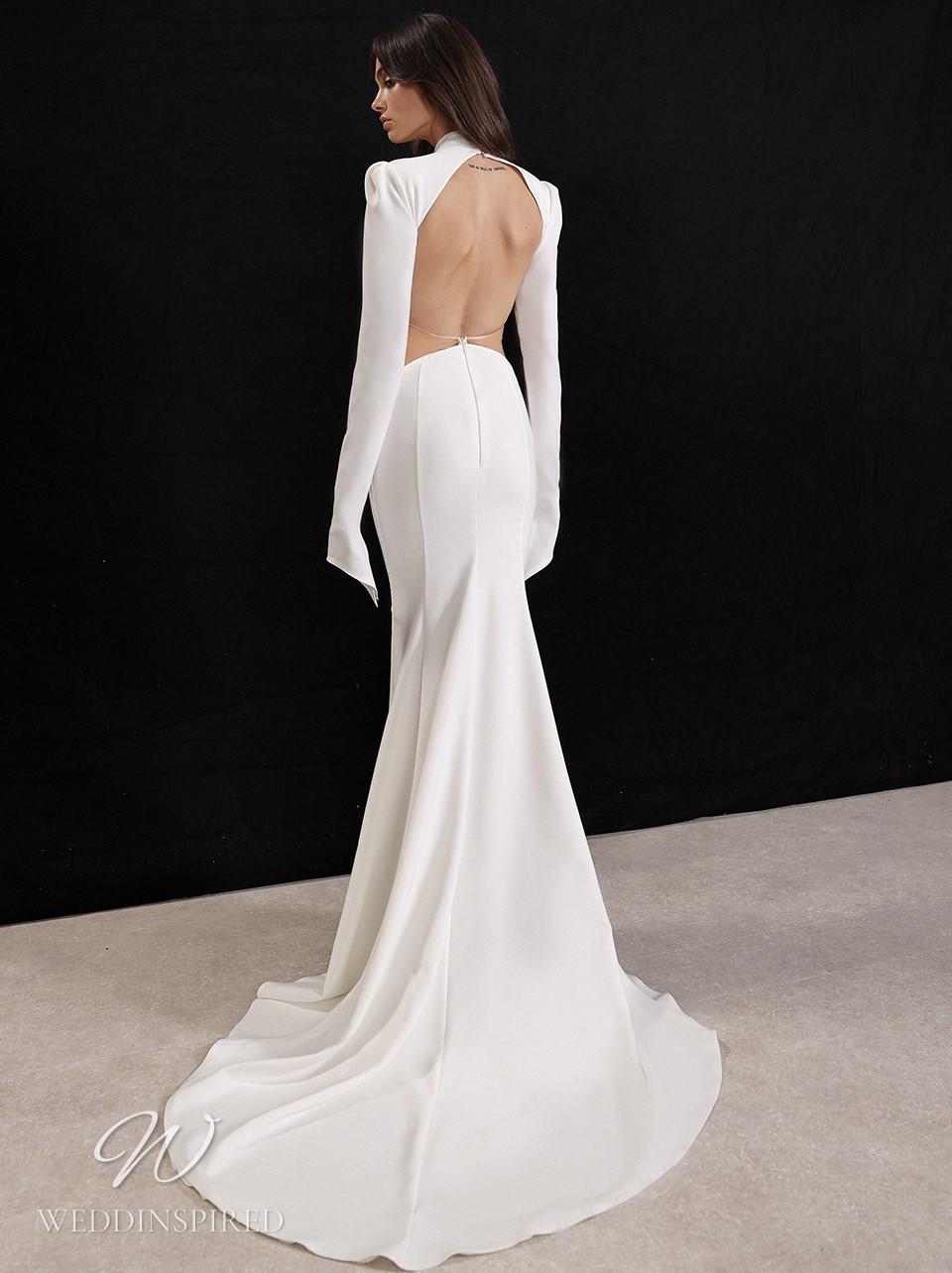 A Galia Lahav 2022 simple mermaid wedding dress with long sleeves and an open back