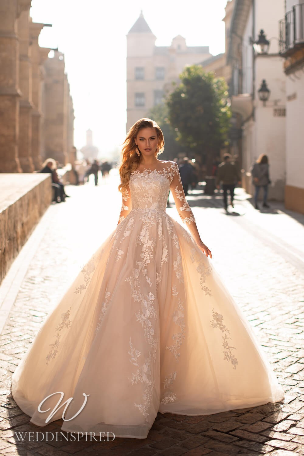 An Essential by Lussano 2021 blush lace princess wedding dress with long sleeves