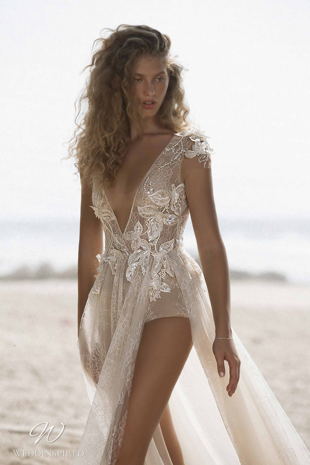 A Muse by Berta ivory lace beach A-line wedding dress with a v neckline and a tulle skirt