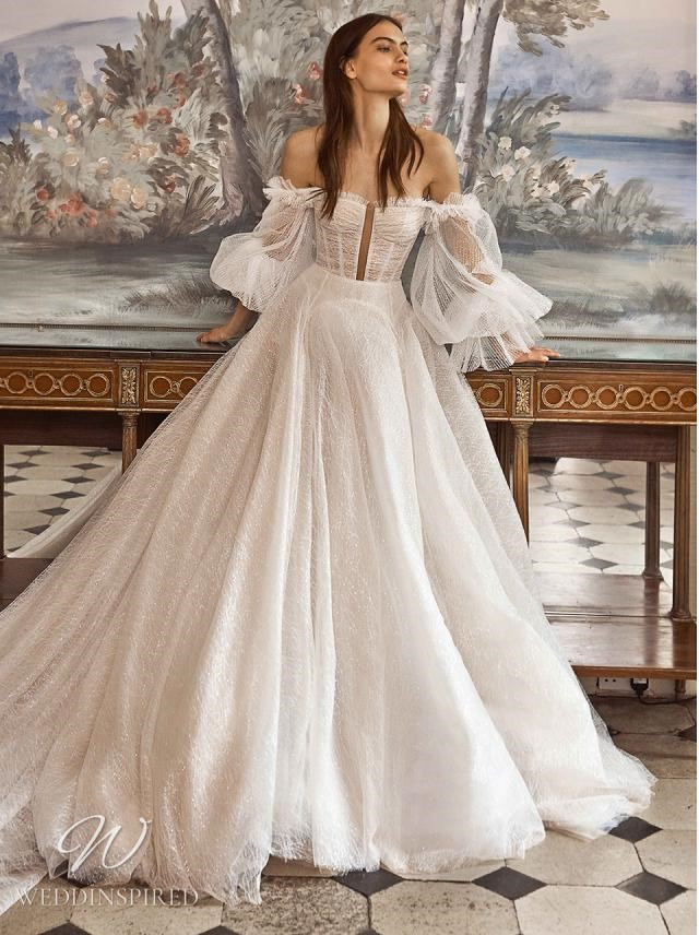 A Galia Lahav 2021 off the shoulder chiffon and tulle ball gown wedding dress with long sleeves