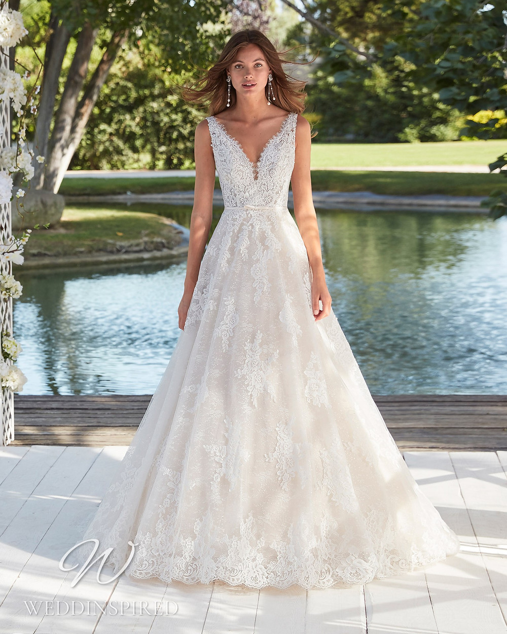 An Aire Barcelona 2021 lace A-line wedding dress with a v neck