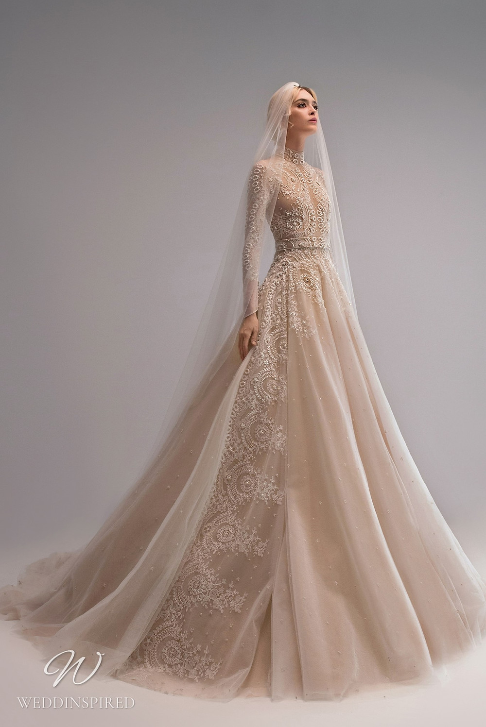 An Ersa Atelier 2021 modest blush ball gown wedding dress with long sleeves and beading
