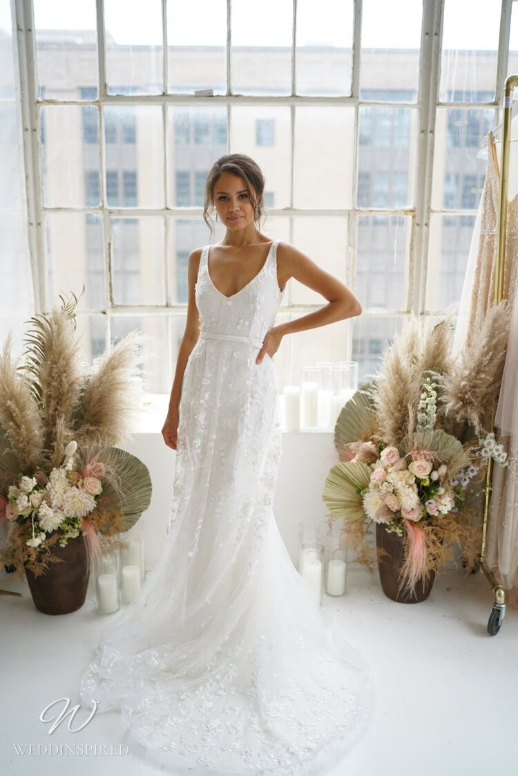 An Anna Campbell 2020 v neck, A-line wedding dress with tulle and beading