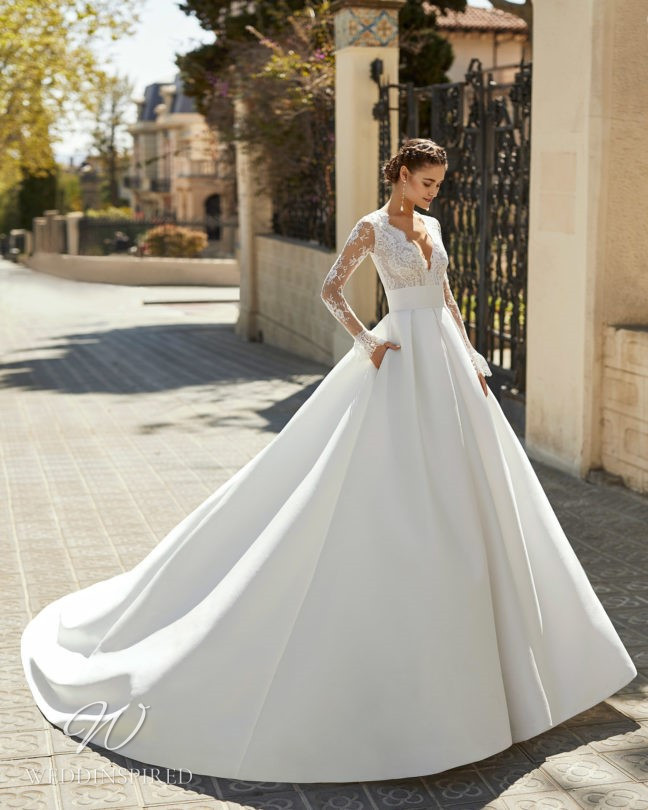 An Aire Barcelona 2021 lace and satin princess ball gown wedding dress with long sleeves