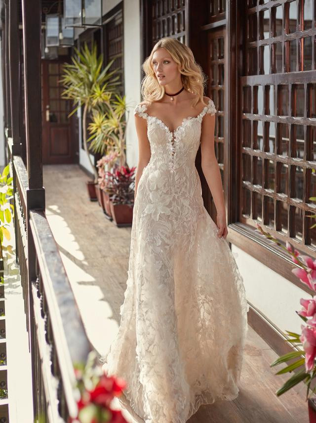 A Galia Lahav off the shoulder ivory lace A-line wedding dress