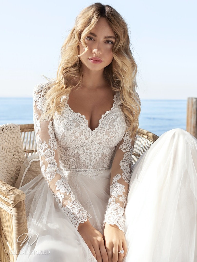 A Rebecca Ingram 2020 lace and tulle A-line wedding dress with long sleeves