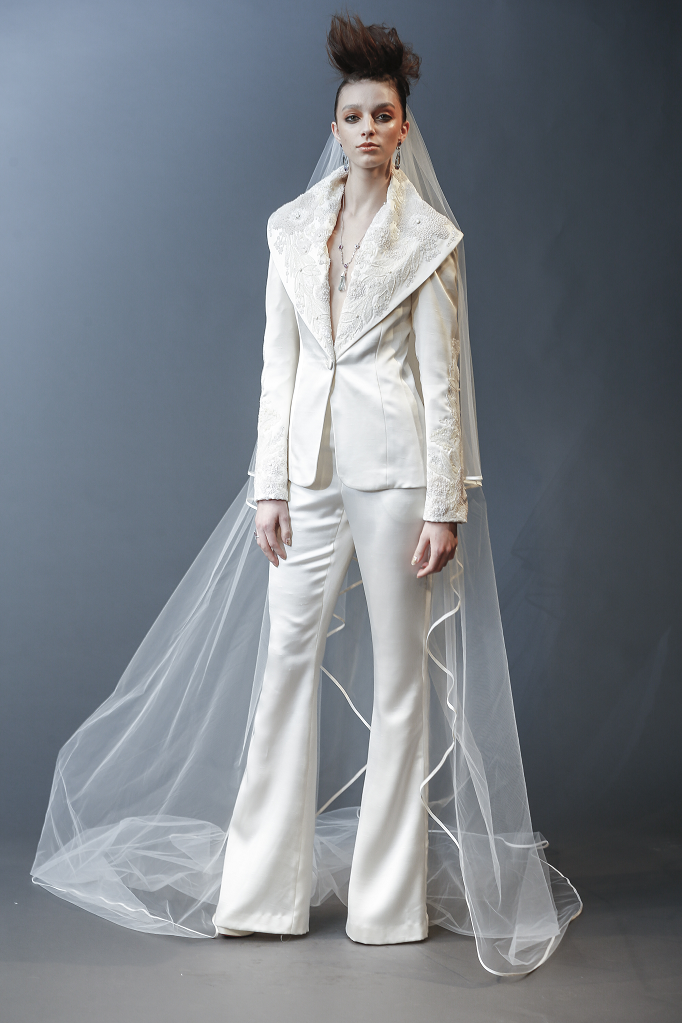 A Naeem Khan ivory wedding pantsuit  with lace and long sleeves