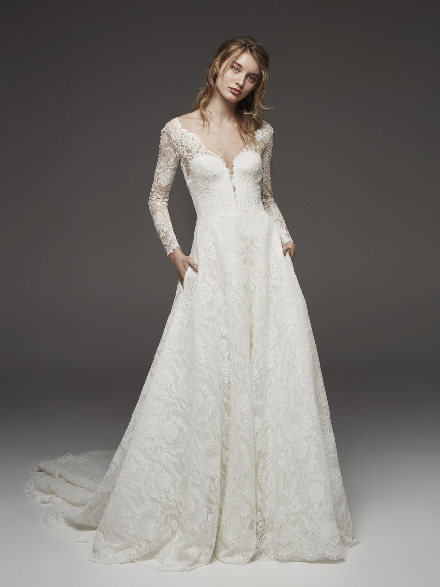 A Pronovias romantic lace A-line wedding dress with pockets and long sleeves