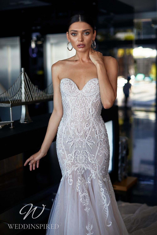 An Ida Torez 2021 strapless lace mermaid wedding dress