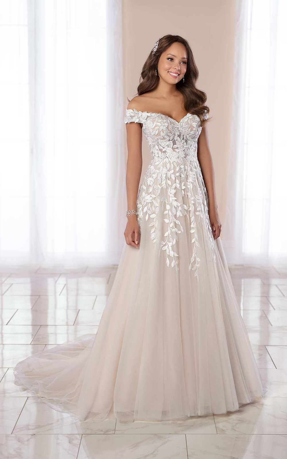 A Stella York 2020 blush off the shoulder lace and mesh A-line wedding dress
