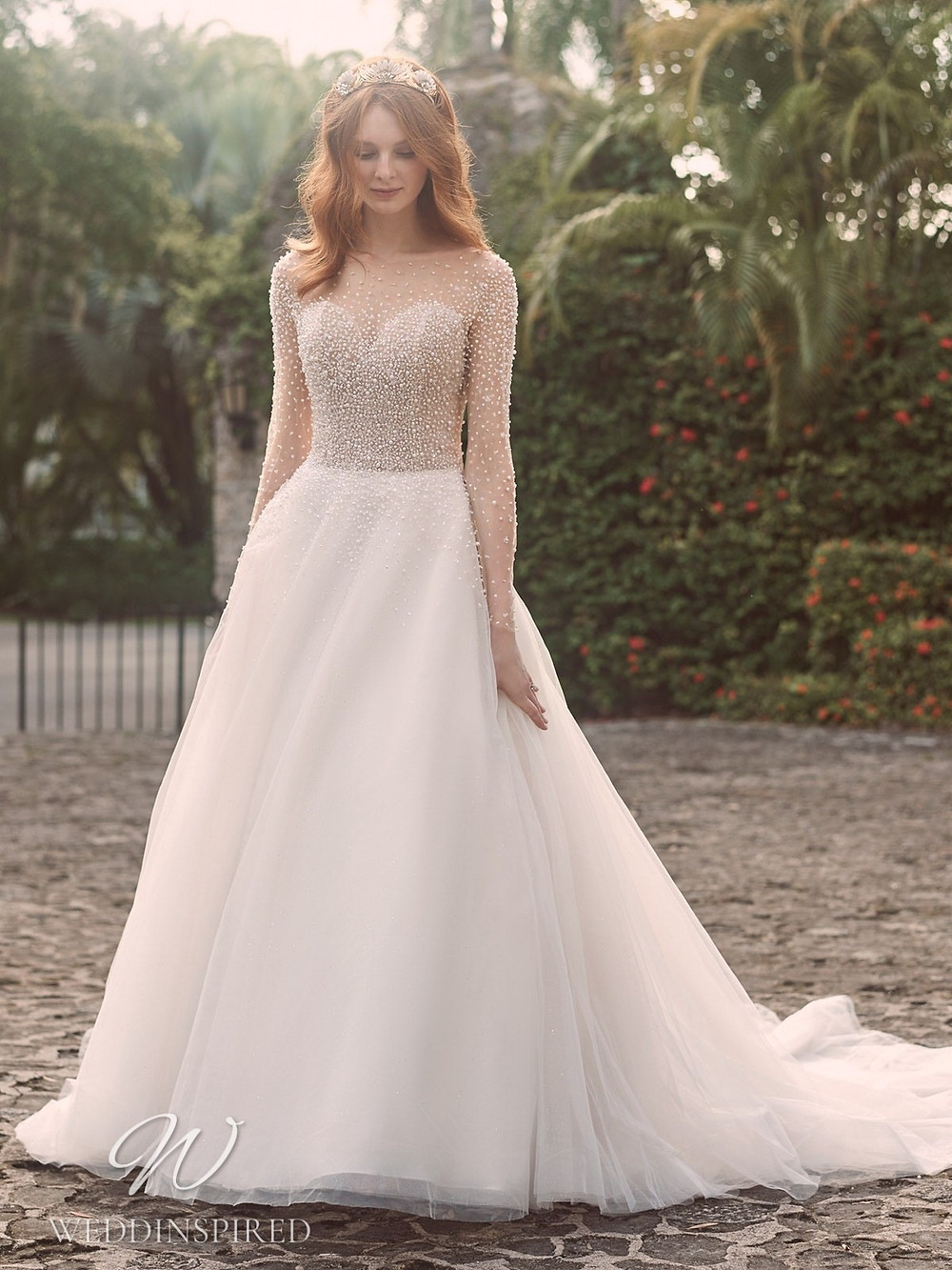 A Maggie Sottero Spring 2021 lace and tulle A-line wedding dress with long illusion sleeves and pearl details