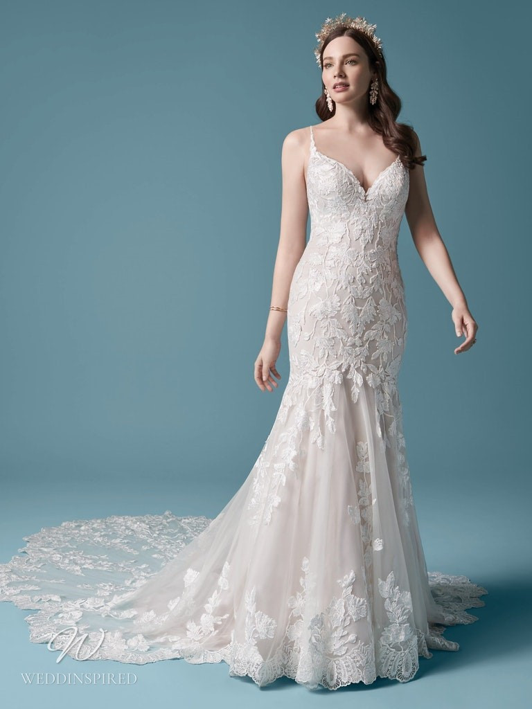 A Maggie Sottero 2021 lace mermaid wedding dress with a train