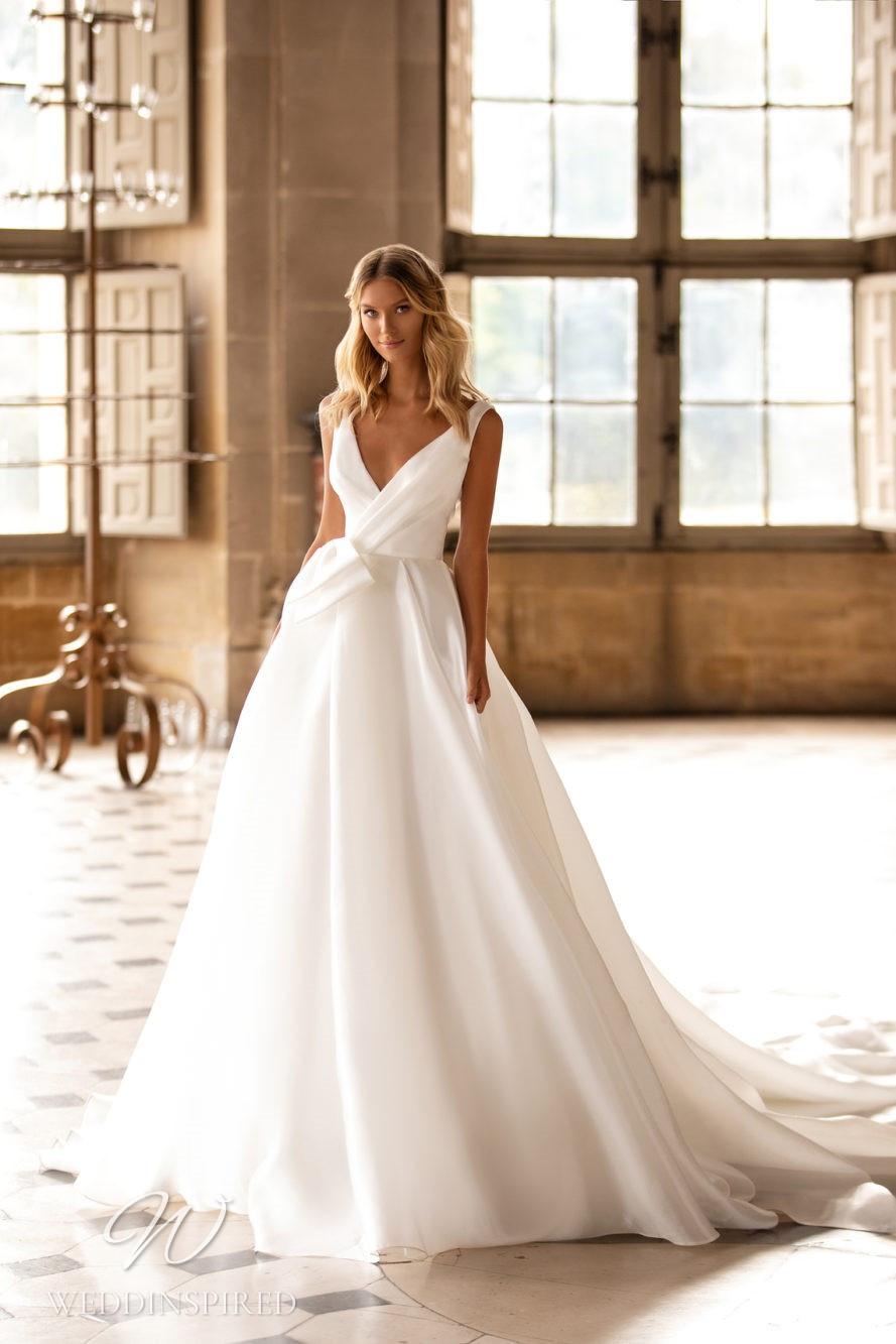 A Milla Nova v neck ball gown wedding dress