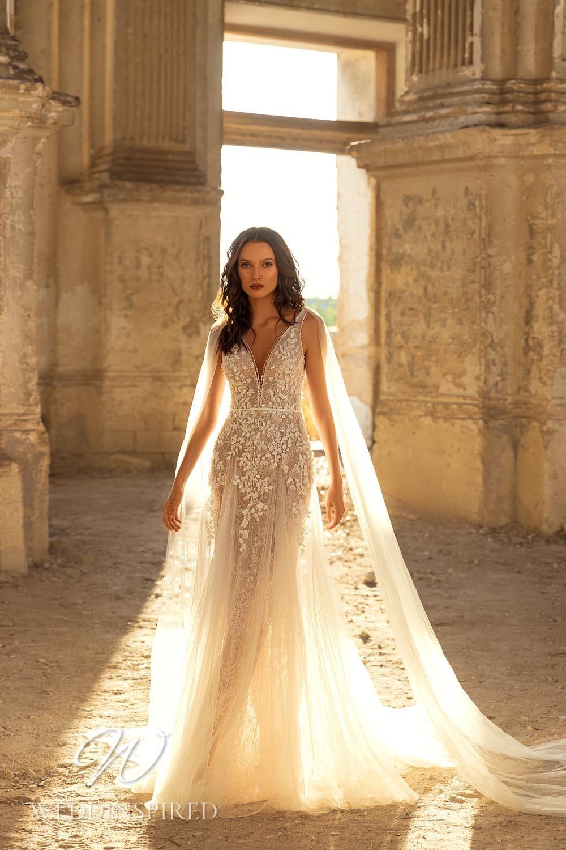 An Eva Lendel 2021 blush tulle mermaid wedding dress