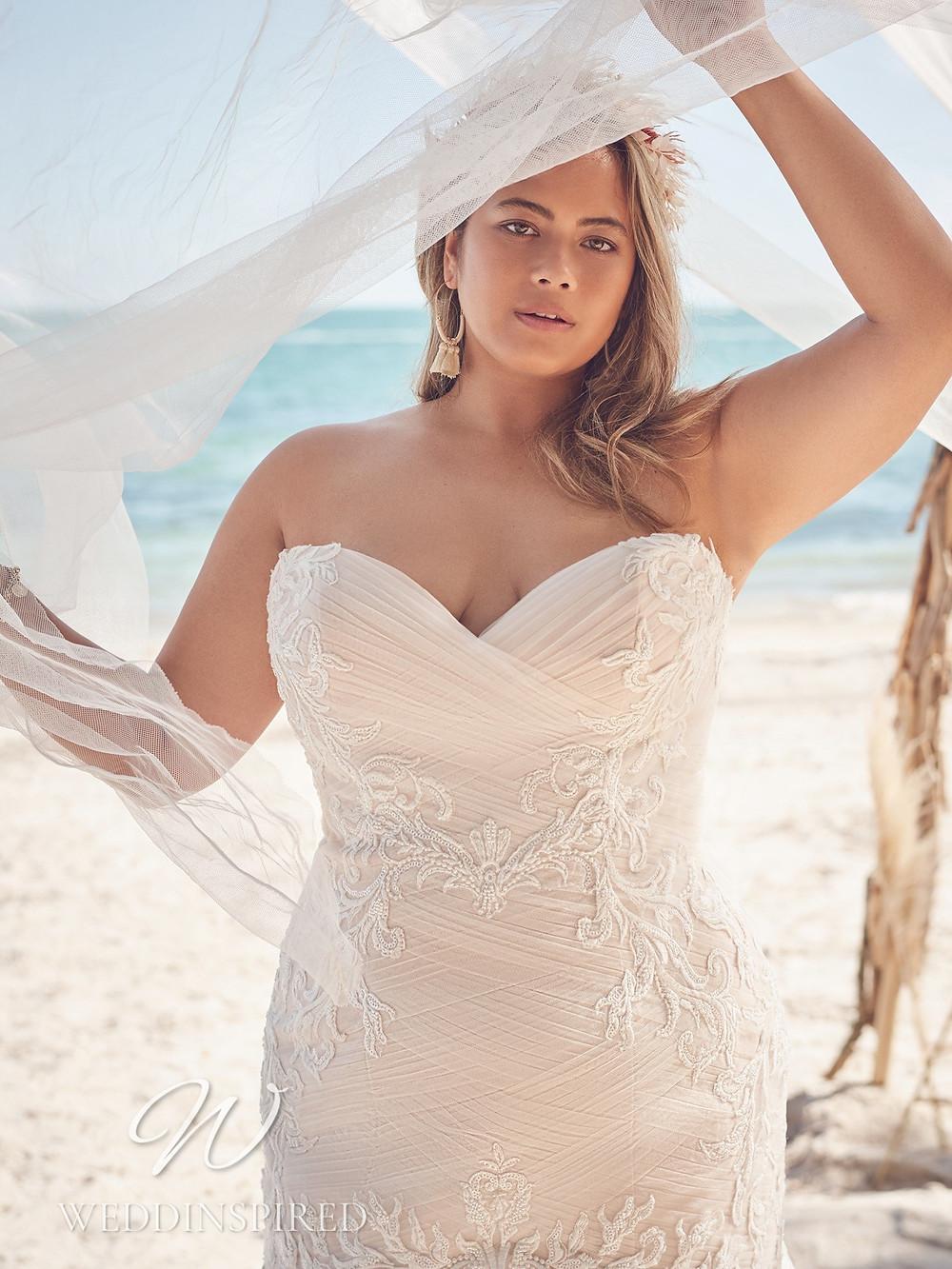 A Rebecca Ingram 2021 plus size ivory strapless mermaid wedding dress