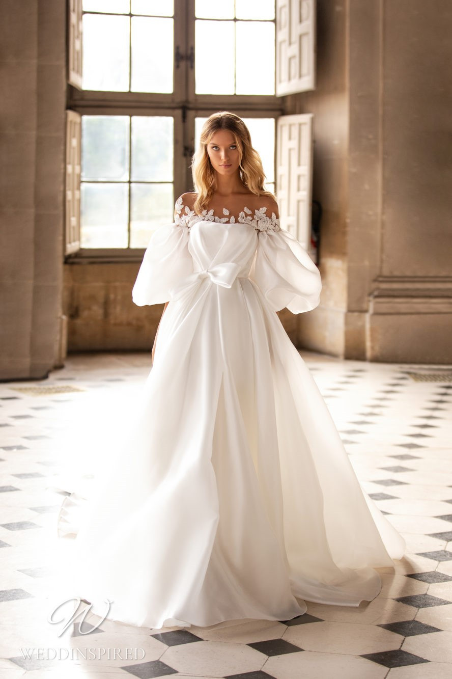A Milla Nova off the shoulder ball gown wedding dress with puff sleeves